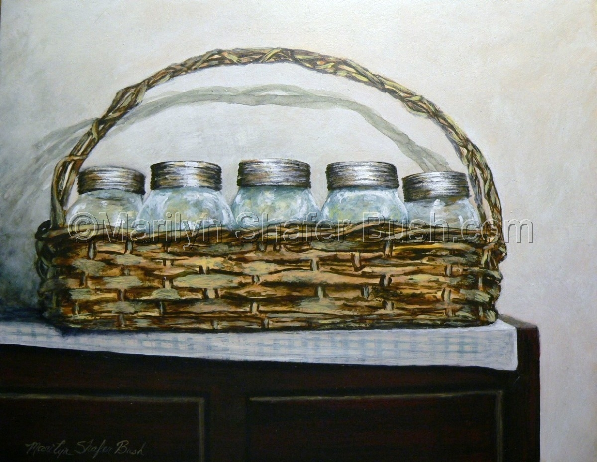 Mason Jars in an old basket on top of a cupboard (large view)