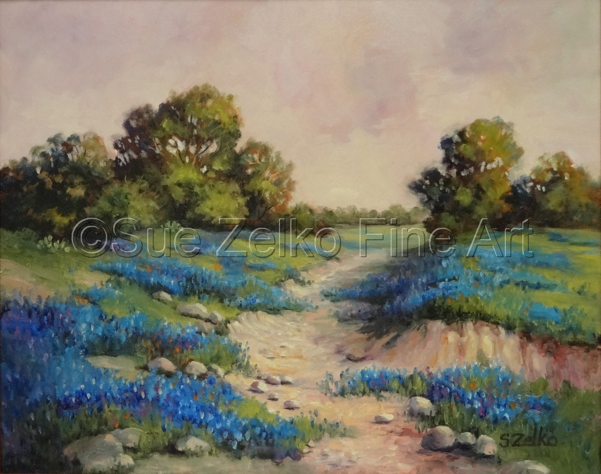 Texas landscape with trees, a ravine, and bluebonnets in green fields (large view)