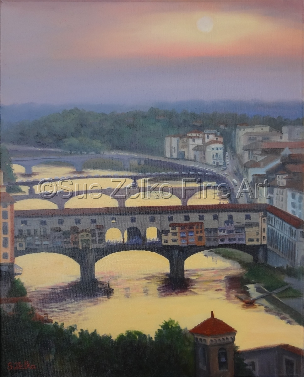 A view of the Ponte Vecchio in Florence, Italy, with sunset reflecting on river Arno (large view)