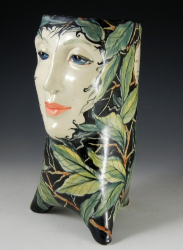 Leafy face vase in black and greens