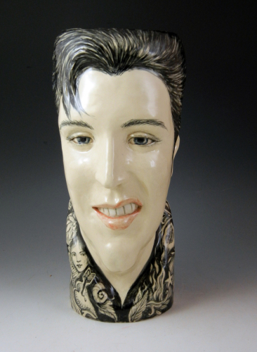 Hand built and painted stoneware face vase with underglaze painting of Elvis (large view)