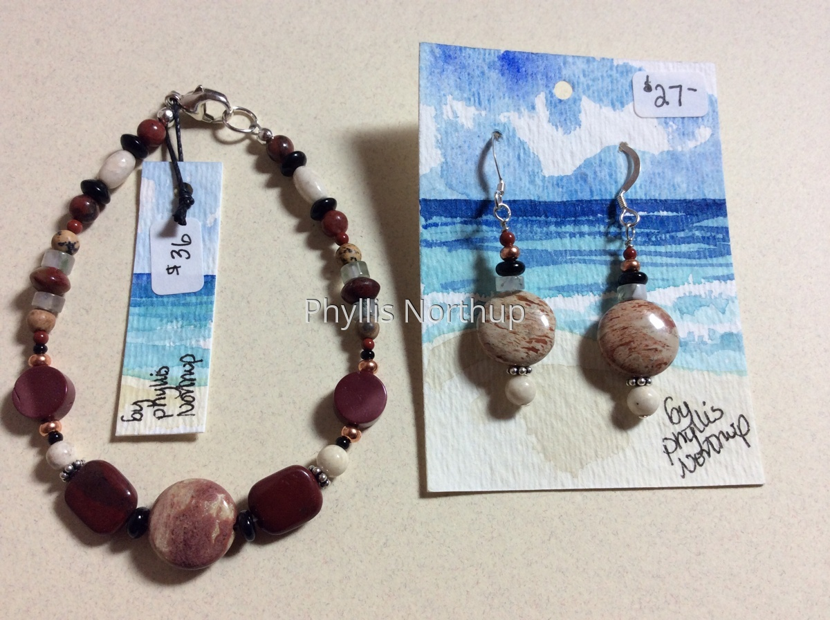 Bracelet and earring set in reds and tans (large view)