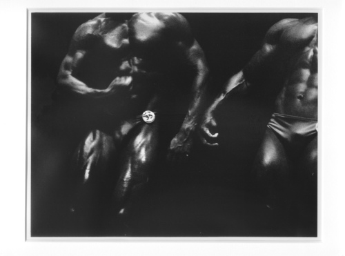 Pose-off Two Bodybuilders
