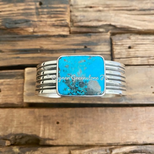 Sterling Stone Kingman Turquoise in hammer set bezel on hand stamped cuff by Regnar Greenstone Jr.