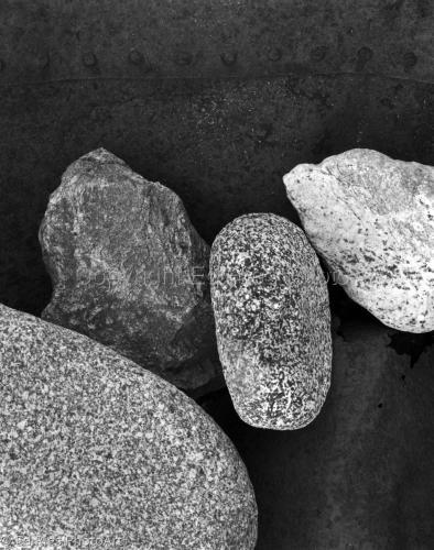 Rocks on rusted metal