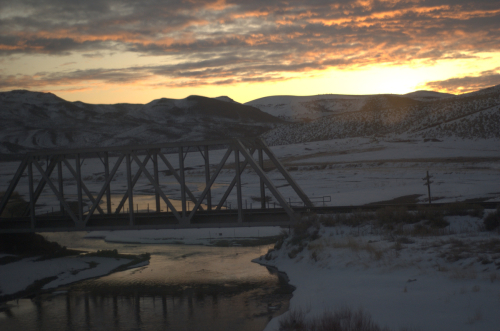 Winter sunrise over train bridge