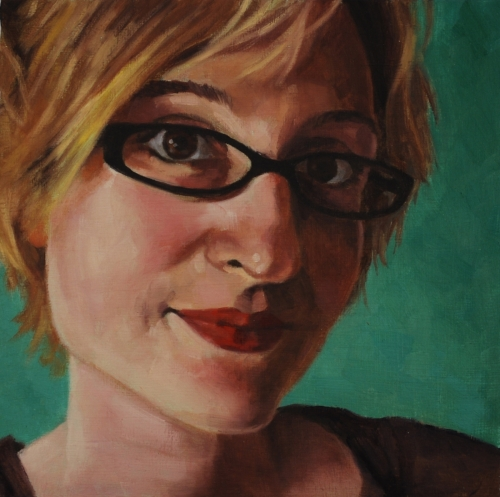 Close up portrait of an attractive woman's face, wearing glasses. Green background. (large view)