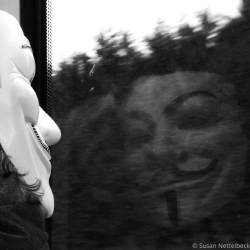 White Masked Man Reflected