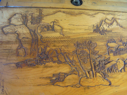 antique child's desk with carved top