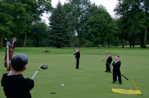 Charlie goes golfing.