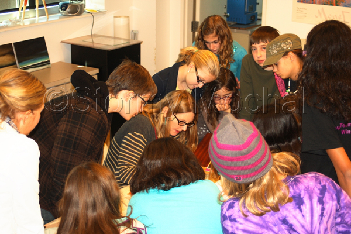 Artist Stormy Mochal demonstrates techniques to a group of students at the Sioux City Art Center.  