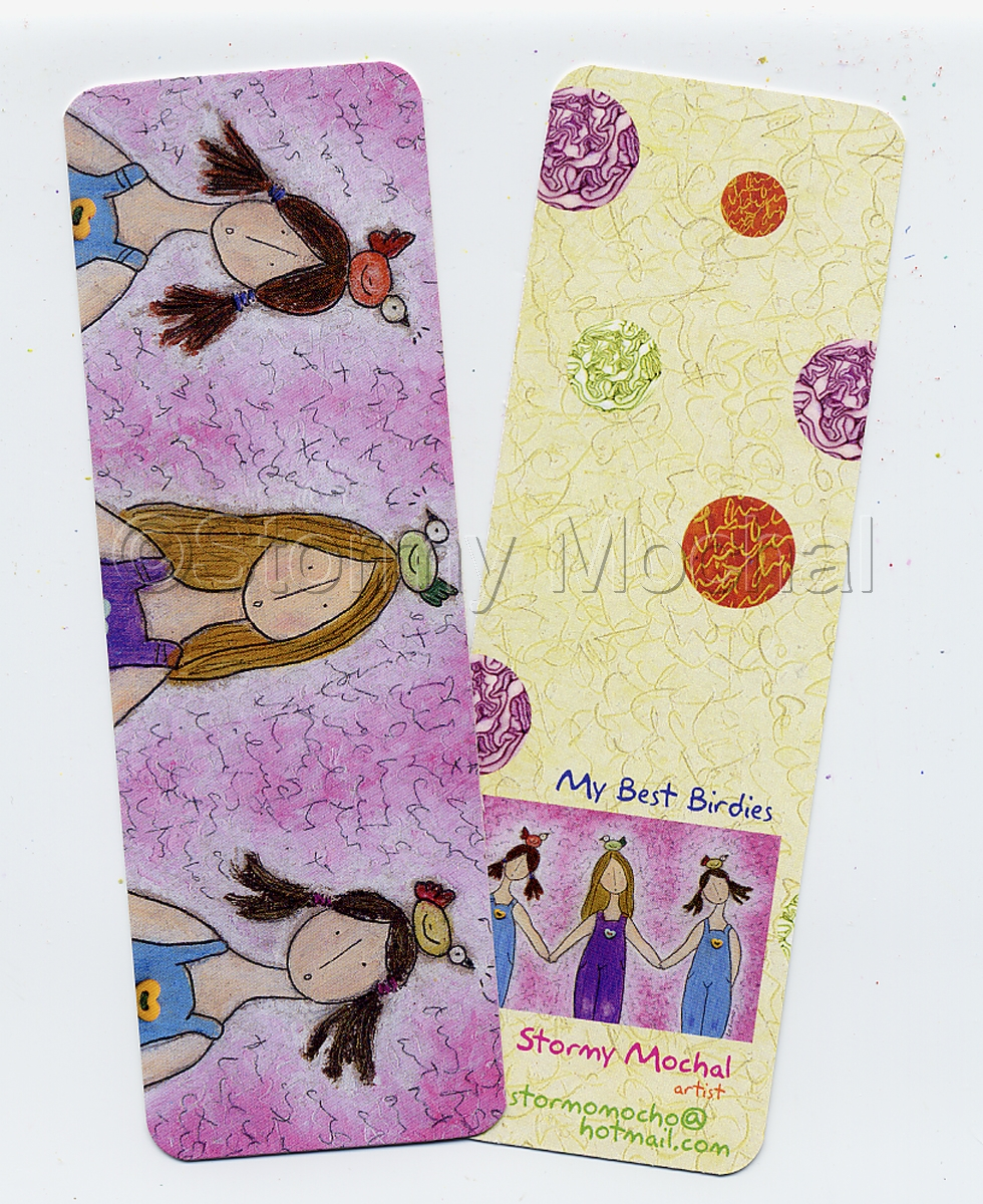Bookmark made of heavy cardstock.  Features three girls with birds on their heads.   (large view)