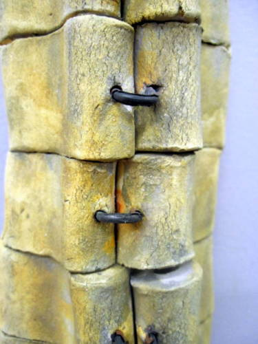 Totemic wall sculpture clay with metal