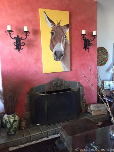 El Hombre above the fireplace