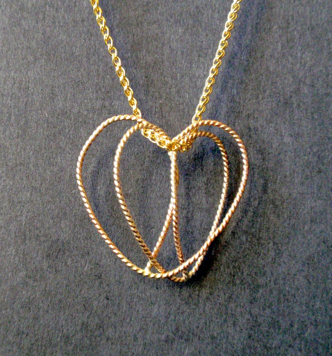 398- MN Two Gold Filled Cross Hearts (large view)