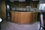 Panoramic view of Deltec kitchen in Florida featuring the marble craftsmanship of artist. (thumbnail)