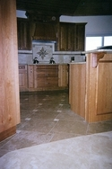 Deltec kitchen floor with custome marble set in a multi-color pin wheel pattern on Florida. (thumbnail)