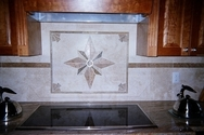 Custom made travertine and tile kitchen backsplash artwork in a Deltec home off the Gulf of Mexico. (thumbnail)