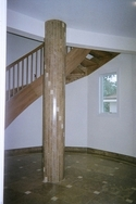 More details of the lobby flooring of a Deltec home with travertine covering on a concrete column. (thumbnail)