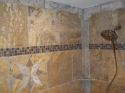 Close-up of marble and glass installation in a Master bathroom by Tiling by Brian (thumbnail)