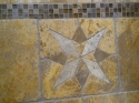 Detail of Travertine marble artwork in master-bath shower. (thumbnail)