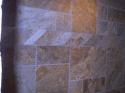 Border tile made from travertine in a guest bathroom shower. (thumbnail)