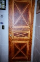 Bedroom door faux-finished with a tortoise shell pattern. (thumbnail)