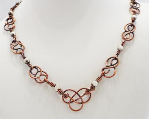 Elegant Celtic Knot Reclaimed Copper and Silver Necklace