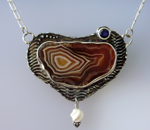 Lake Superior Agate Polished Slice in Sterling Cast Pendant with Faceted Iolite