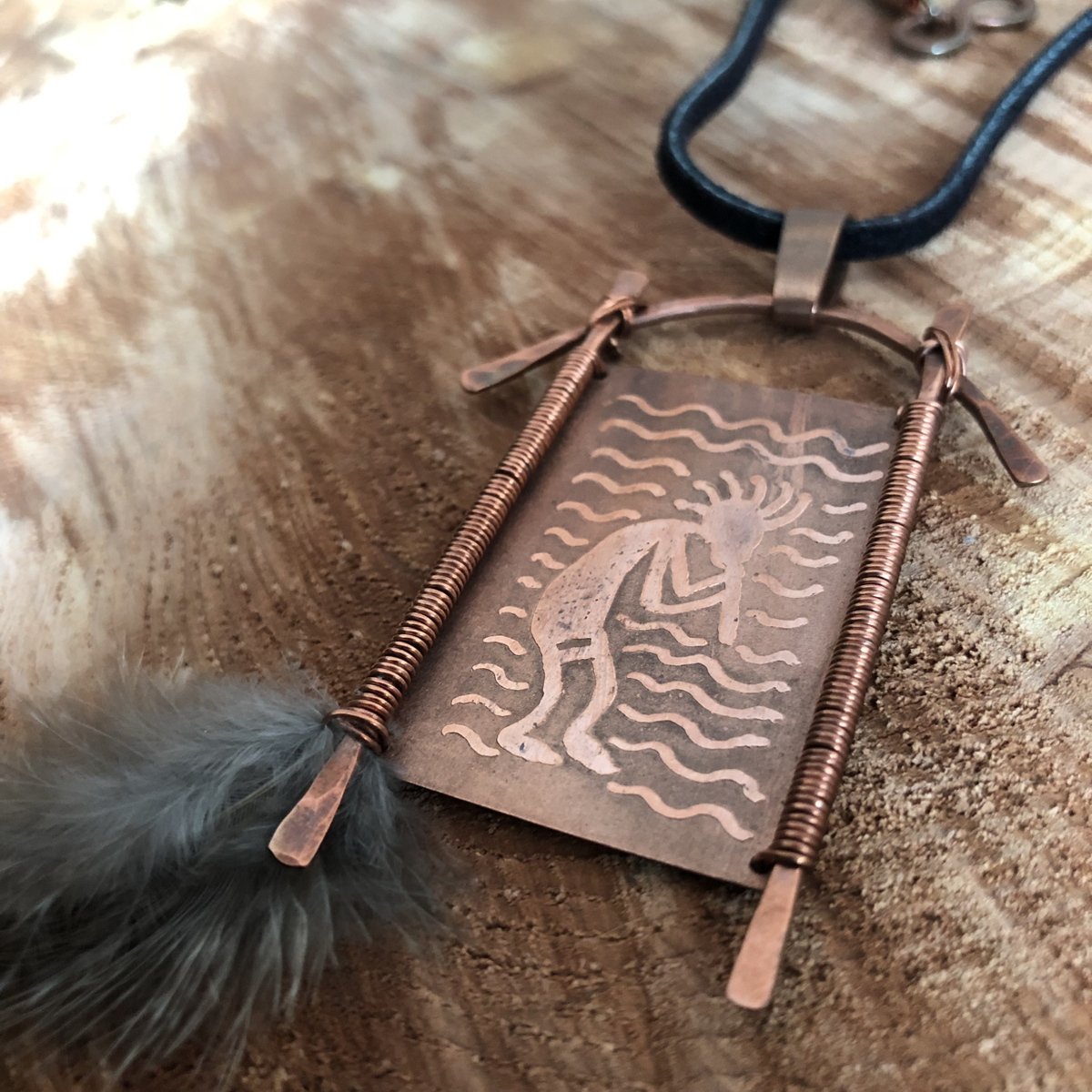 Kokopelli: Etched Pendant With Pheasant Feather (large view)